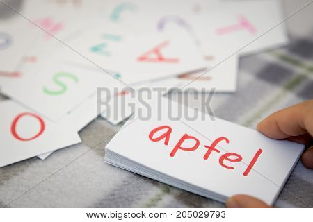 German; Learning The New Word With The Alphabet Cards; Writing Apple