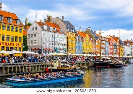 COPENHAGEN, DENMARK - JULY 20: Nyhavn, 17th century waterfront, canal and entertainment district and the popular tourist destination in Copenhagen, Denmark
