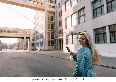 Passerby talk on phone in city on street. Modern telecommunication, social media technology