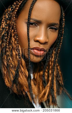 Distrustful African American woman. Sad emotion. Stress mood, incredulous look on black background, problems in life, sadness concept