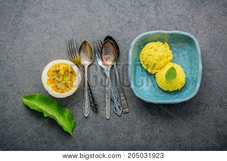 Composition Of Ice Cream Passion Fruit Flavor In Vintage Bowl Setup On Dark Stone Background . Passi
