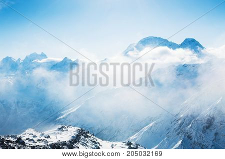 Snow-covered Mountains At Sunset.