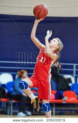 Girl Athlete With Injury Of Fingers In Uniform Playing Basketball