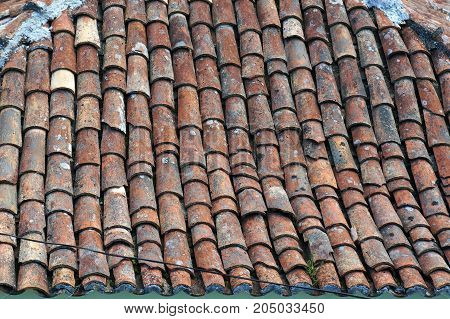 Old tiled roof in Portugal. Architectural textured background.