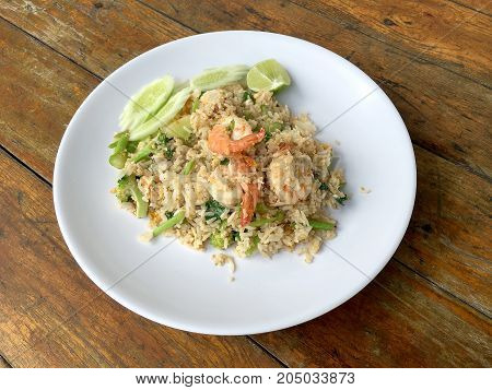 Delicious Shrimp Fried Rice In White Dish On Wooden Table. Thai Food.