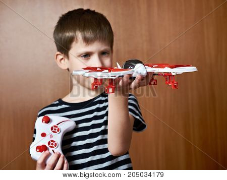 Little Boy With Toy Quadcopter Drone