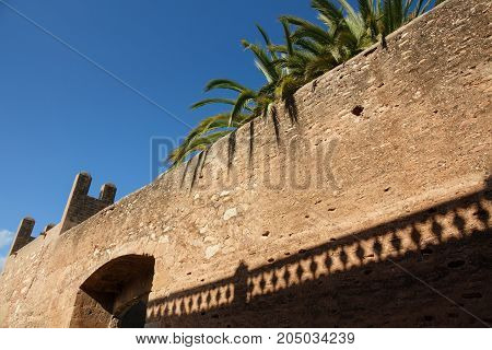 Wide angle perspective view of city walls and house roofs shadow