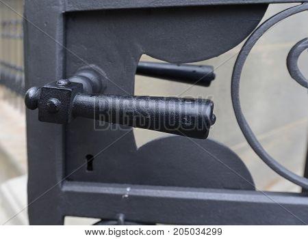 Black metal door handle on exterior metal door
