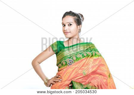 Happy young beautiful traditional Indian woman in traditional saree