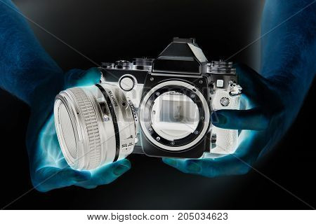 Negative Photo Of Slr Camera In Hands Photographer Closeup