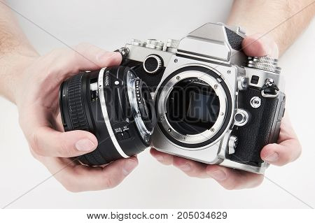 Retro Photo Slr Camera In Hands Of Photographer Closeup