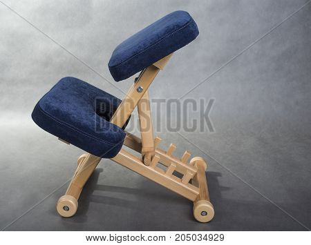 Kneeling chair for healthy sitting. Knee chair support your back.