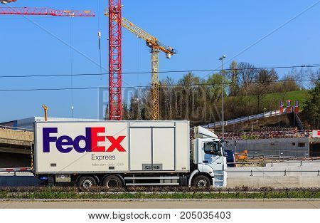 Kloten, Switzerland - 28 March, 2017: a truck of the FedEx company on the road. FedEx Corporation is an American multinational courier delivery services company headquartered in Memphis, Tennessee.