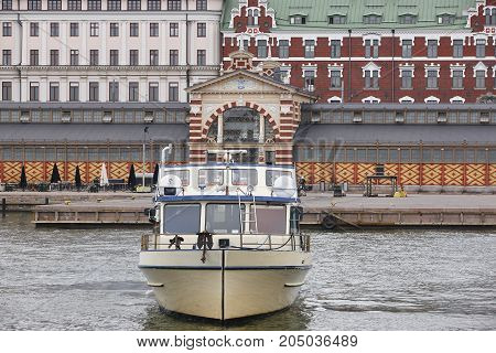 Helsinki city center and harbor. Traditional brick colored buildings. Finland