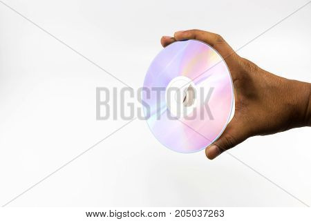 Cd-rom Disc With Rainbow Reflective Light In Man Hand