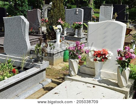 Tombstones in the Public cemetery in summer