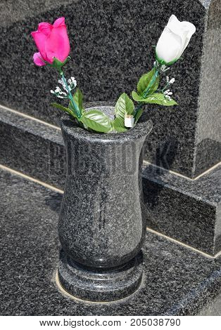 Vase on the Tombstones in the Public cemetery in summer