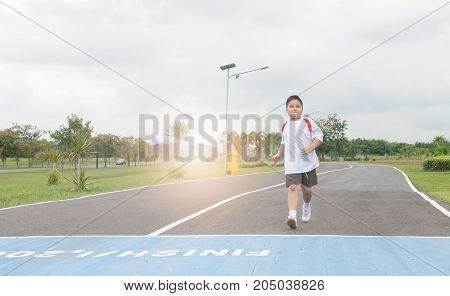 Obese Fat Boy Running To The Finished Line.