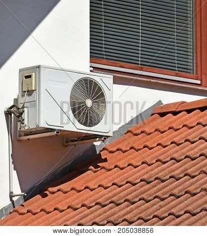 Air conditioner on the wall of a house