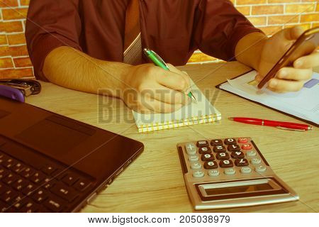 The calculators business owners accounting and technology business computer laptop calculator and documents in the office. business male hands in office - Retro color