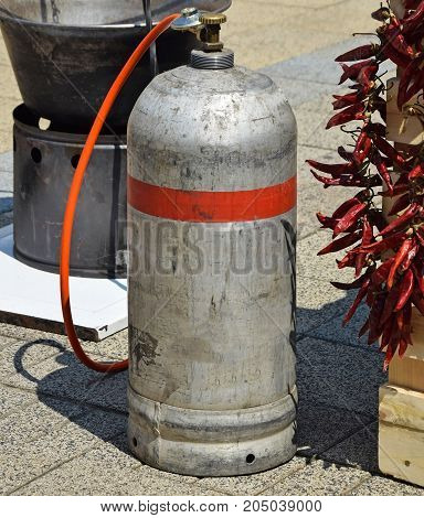 Gas container for cooking outdoor in summer