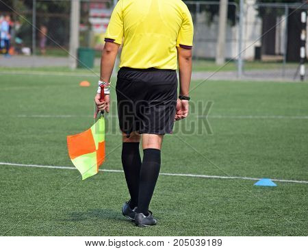 Referee of the soccer Match outdoor in summer