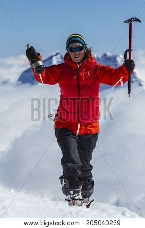 A women fririder on a mountain top
