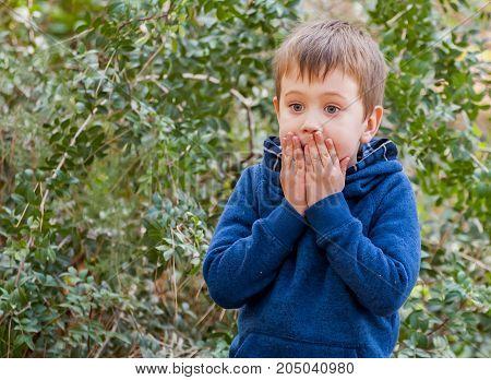 A scared closeup facial expression of a Caucasian child. Afraid of punishment