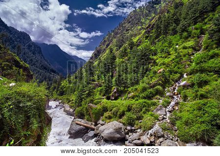 Landscape of a mountain river with traditional nature of Kullu valley. Naggar Himachal Pradesh. North India.