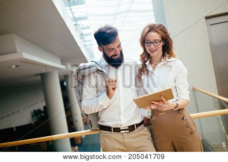 Picture of handsome businessman and beautiful businesswoman in company
