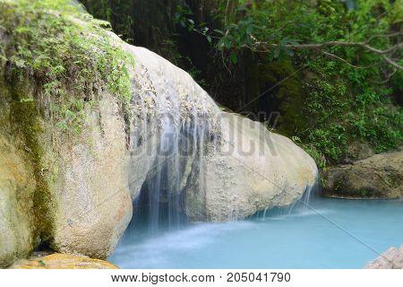 Water flowing over rock (phu pha erawan),erawan waterfall national park,kanchanaburi,thailand.