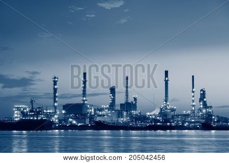 Oil refinery plant and loading dock at twilight.