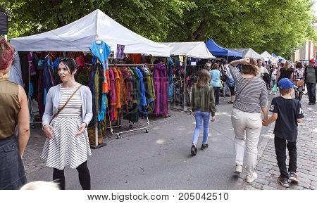 TURKU, FINLAND ON JUNE 30. Street view of people walk around the stands, business on the Medieval Market on June 30, 2017 in Turku, Finland. Unidentified people. Editorial use.