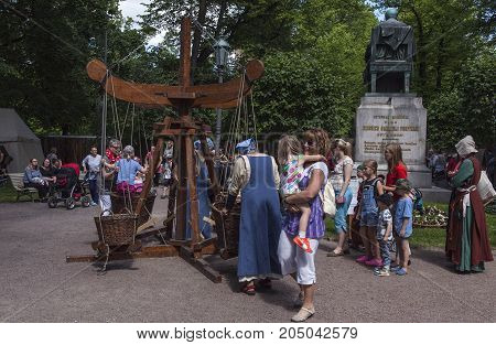 TURKU, FINLAND ON JUNE 30. Street view of people, kids in a playground on the Medieval Market on June 30, 2017 in Turku, Finland. Unidentified people. Editorial use.