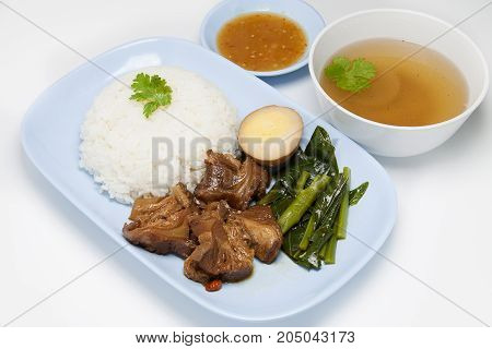 Stewed pork on rice isolated on white background.