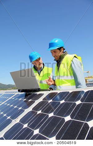 Engineers checking solar panel setup