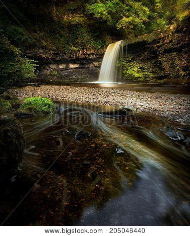A full flow over Lady Falls or Sgwd Gwladus on the river Afon Pyrddin near Pontneddfechan