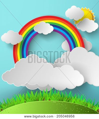Abstract paper rainbow on sky with clouds and sun.
