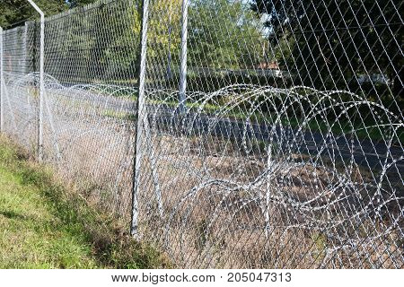 A Barbed Wire Use Fence To Prevent Intrusion
