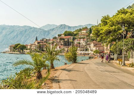 PERAST, MONTENEGRO - AUGUST 24, 2017:  View of the embankment in the city of Perast in Kotor Bay, Montenegro.