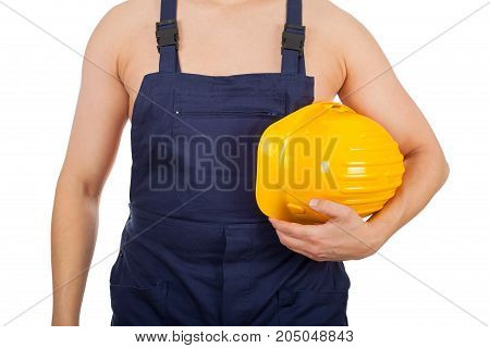 Picture of a shirtless young constructor wearing navy blue uniform on isolated background