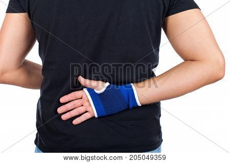 Close up picture of young male with blue elastic bandage on his wrist on isolated background