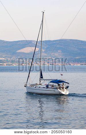 Scenic picture of a white yacht on the adriatic sea dalmatian coast in Trogir Croatia White yacht on the adriatic sea Trogir Croatia