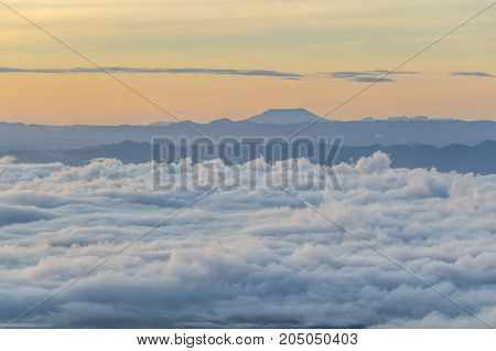 Mountain range tropical rainforest canopy at Petchaboon, Thailand with more cloud sunset time and sea mist, copy space for text layout.