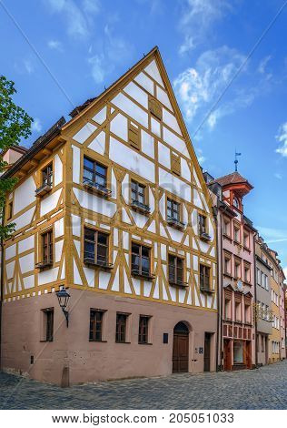 Street with historical houses in Nuremberg old town Germany