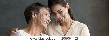 Friendly Caregiver And Elderly Woman