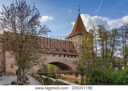Pedestrian chain bridge (Kettensteg) and the medieval city wall behind it Nuremberg Germany.
