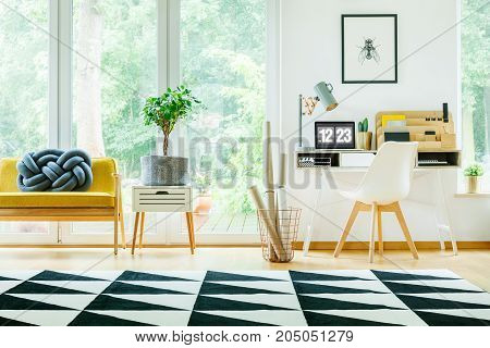 Spacious Workspace With White Chair