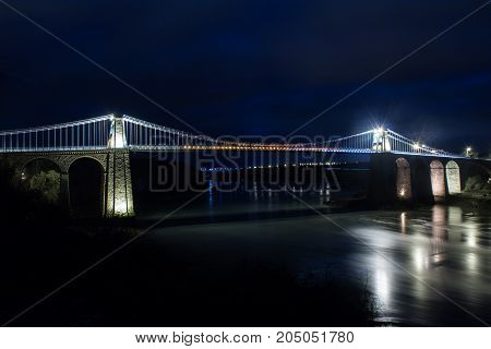 The Menai Suspension Bridge is a suspension bridge to carry road traffic between the island of Anglesey and the mainland of Wales. The bridge was designed by Thomas Telford and completed in 1826 and is a Grade I listed building.