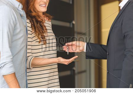 Agent Giving Keys To Woman